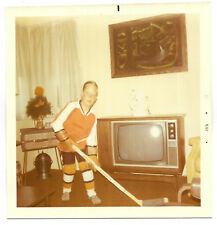 Square Vintage 70s PHOTO Young Boy Wearing Hockey Uniform w/ Stick In TV Room