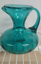Water Pitcher with handle clear Teal in color