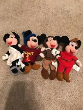 Assorted Mickey Mouse stuffed animals