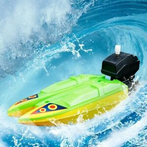 NEW WIND UP BATH TOY BOAT FOR KIDS. Random colors.