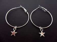 "A PAIR OF SIMPLE SILVER COLOUR 35 MM 1.5"" HOOP & STAR  EARRINGS. NEW."