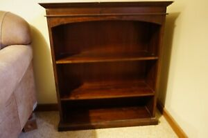 Small dark brown timber / wooden Freedom bookcase