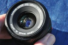 Canon FD 28mm f2.8 Lens and caps