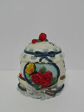 Beautiful Sugar bowl of porcelain with decorations in relief