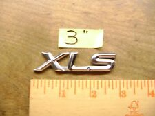"XLS chrome plastic emblem will fit several different vehicles 3"" long"