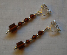 Hand made clip on earrings silver plated amber colour cube glass beads unique
