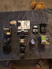 canon ae-1 program 35mm film camera + 50mm f1.8 + extras