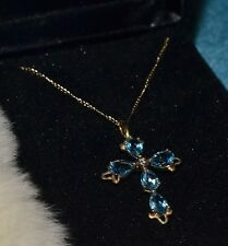 Blue topaz and diamond pear cross pendant/necklace in 14k gold