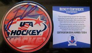 JACK EICHEL BUFFALO SABRES SIGNED USA HOCKEY PUCK BECKETT BAS COA T23214