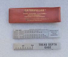 2 Caterpiller Tractor Co. tire tread & percent medal rulers in pocket  pouch