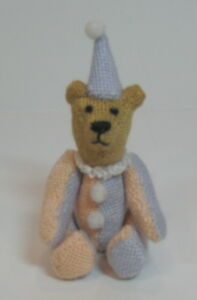 Miniature hand needlepointed hinged teddy bear.