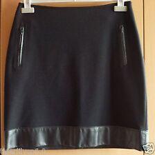 Zwarte rok uit 2 materialen  Maat 38