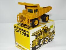 Conrad No 276 is the model of the Cat 769 Dump truck Pacman colours VNMB