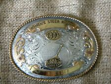 Montana Silversmith BELT BUCKLE CHAMPION Women steer riding 1990 sterling SILVER
