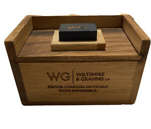 Wiltshire and Grannis LLP wooden puzzle box attorney advertising