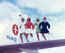 Photo. 1969-70. New Zealand. Air Hostesses on Plane Wing Various Uniforms