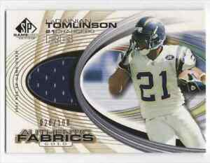 2004 SP GAME USED EDITION AUTHENTIC FABRICS LADAINIAN TOMLINSON GOLD SP #D /100