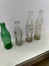 Vintage Coca Cola Bottles Three Clear, One Green