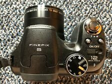 Fujifilm FinePix S1800 12.2 MP Digital Camera with 18x Wide Angle 3-Inch LCD
