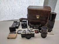 Minolta XG 7 35mm SLR Film Camera with Lens, Filters, Flash, Auto Winder, & Case
