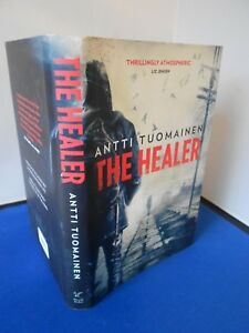 ANTTI TUOMAINEN: THE HEALER: FIRST EDITION FIRST PRINT: VERY GOOD COPY
