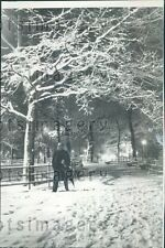 1958 Night Scene Man Walks Alone Snow Covered Madison Square Park Press Photo
