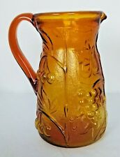 Amber Pressed Glass Pitcher With A Grape & Leaf Pattern 7 1/4""