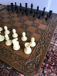 Antique and very large chess board [60 x 60 cm]and complete chess set of figures