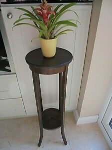 Tall dark wood  2 tier plant stand wine table, under shelf, lamp torchere