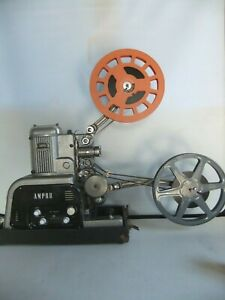 Ampro 16 mm projector with carrying case/speaker and mains lead and test film