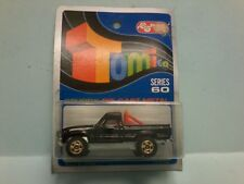 TOMICA TOYOTA HILUX 4WD on Blue card MADE FOR G.J COLES  MELBOURNE AUSTRALIA
