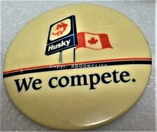 """HUSKY OIL & GAS CANADA WE COMPETE DOGS HEAD FLAG BUTTON 2 1/4"""""""