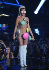 A Miley Cyrus With Long White Boots 8x10 Picture Celebrity Print