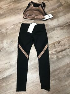 Fabletics Gold And Black Bra And Leggings Xsmall