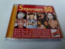 """CD """"SUPERSTARS 80"""" CD 18 TRACKS QUEEN A-HA WHAM SADE DURAN DURAN EURYTHMICS TINA"""