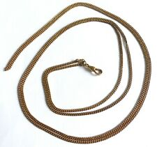 A VICTORIAN ROLLED GOLD GUARD CHAIN WITH ALBERT ATTACHED