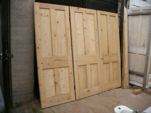 Reclaimed Victorian stripped pine four panel doors.
