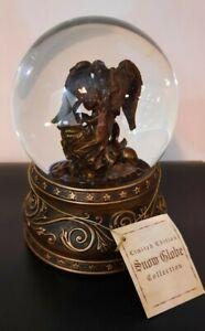 "Cherubim Angel musical Snow Globe, plays ""Joy To The World"", gold, copper base."