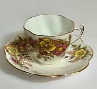 Vintage Rosina Tea Cup and Saucer Set Flowers Yellow and Pink Bone China England