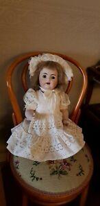 Doll - antique reproduction, sleep eyes. EC