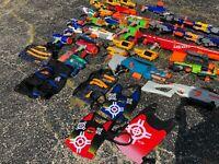 Nerf Gun Lot - 27 guns, 5 vests , 1 carrying bag rare guns