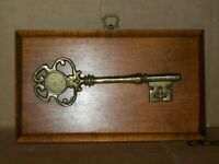 "7.5"" BRASS SKELETON KEY MOUNTED ON 6"" x 10"" WOODEN PLAQUE"