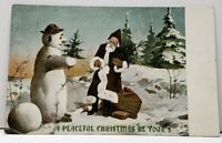Peaceful Christmas Brown Robed Santa Claus with Snowman c1905 Postcard F15