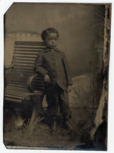 AFRICAN AMERICAN BLACK YOUTH WITH TINY LOCKET LEANS ON BENCH TINTYPE