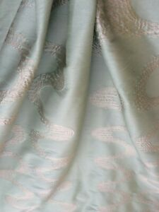 STYLISH pale Aquamarine fabric.Poly silk with lovely ivory embroidery. Limited