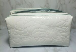 30 X ESTEE LAUDER WHITE FLOWER EMBOSSED MAKEUP COSMETIC TRAVEL BAG 10*5*2 INCH