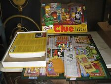 2 Simpson board games CLUE second edition  and WHEEL OF FORTUNE