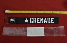 2016 NWT GRENADE GLOVES WRISTLET KEYCHAIN $9 ribbon black screen print logo