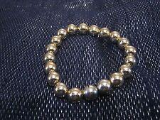 Simple gold tone plastic elasticated beaded bracelet
