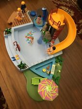 Playmobil swimming pool set Accessories And 7 Family Figures Included A Police